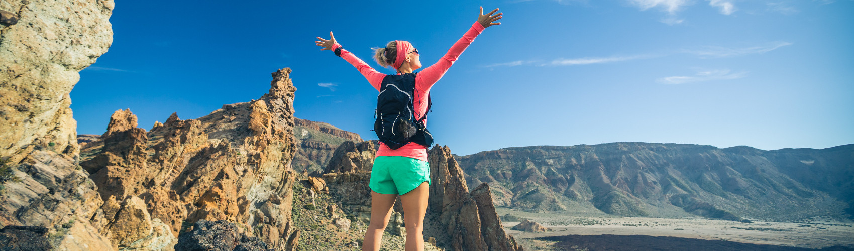 woman-hiker-with-arms-outstretched-enjoy-PKXBG5H-1